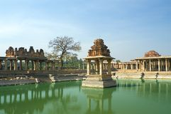 Ancient water pool. And temple at Krishna market, Hampi, Karnataka state, India Stock Images