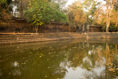 Ancient Water Pool by a Broken Temple Wall in Angkor stock images