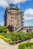 Ancent water tower in Dordrecht, Netherlands. Ancient water tower, rebuild and converted into an hotel and  restaurant with a vegetable garden called Villa Royalty Free Stock Photography