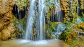 An ancient waterfall resembling a skull. 4K timelapse.  stock video