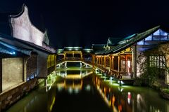 Ancient Watertown in China at night, Wuzhen near Shanghai. Bridge and houses Royalty Free Stock Photos