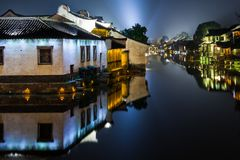 Ancient Watertown in China at night, Wuzhen near Shanghai - houses. Ancient Watertown in China at night, Wuzhen near Shanghai - bridge and houses Stock Image