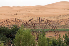 Ancient waterwheels on a background of desert and Yellow River, Royalty Free Stock Image
