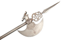 The ancient weapon - a halberd. It is isolated on a white background Royalty Free Stock Photos