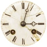 Ancient weathered clock face with cracks. Isolated on a white background stock image