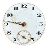Ancient weathered clock face with cracks. Isolated on a white background stock images