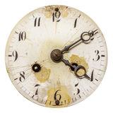Ancient weathered clock face isolated on white. Ancient weathered clock face with cracks isolated on a white background stock photography
