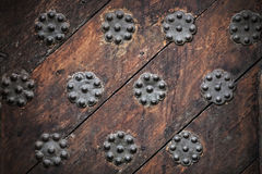 Ancient weathered door background texture. With metal decorative elements. Old part of Tallinn, Estonia Stock Image