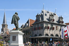 Ancient weigh house and tourists in dutch city Hoorn stock image