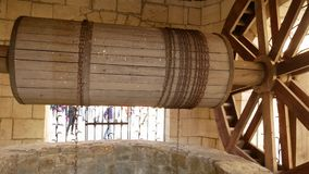 An ancient well with. A large wooden drum and a rusty chain stock footage