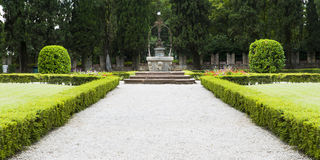 Ancient well in the garden of the castle of Conegliano Stock Photo
