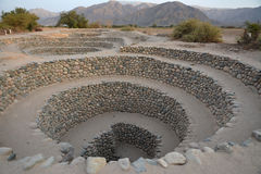 Ancient wells near town Nazca. Peru. Royalty Free Stock Photo