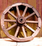An ancient wheel. Wooden ancient wheel / background of wood Royalty Free Stock Image