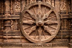Ancient Wheel. Ancient wall wheel sculptors at the Konark sun temple in Orissa Royalty Free Stock Images