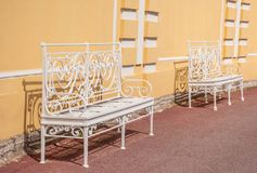 Ancient white benches. Ancient white fishnet benches in the park Stock Photos