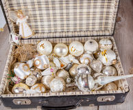 Ancient white Christmas tree toys in antique suitcase. Ancient old white Christmas tree toys in antique suitcase Stock Photo