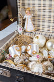 Ancient white Christmas tree toys in antique suitcase. Ancient old white Christmas tree toys in antique suitcase Royalty Free Stock Photography