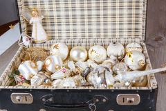 Ancient white Christmas tree toys in antique suitcase. Ancient old white Christmas tree toys in antique suitcase Stock Photography