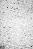 Ancient white headstone, Arabic script carving Stock Image