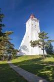 Ancient white lighthouse in Hiiumaa, Estonia. Big ancient tall white lighthouse in summer in Kopu, Hiiumaa, Estonia Stock Images