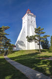Ancient white lighthouse. Big ancient tall white lighthouse in summer in Kopu, Hiiumaa, Estonia Royalty Free Stock Image