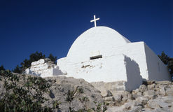 Ancient White Orthodox Church. Orthodox Medieval white stone church on the rock in Rhodes, Greece royalty free stock photos