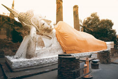 Ancient white Reclining ฺฺBuddha statues and ruined pagoda at Wat Yai Chai Mongkhon temple in Thailand. Royalty Free Stock Image