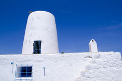 Ancient white salt windmill mill in Formentera Stock Images