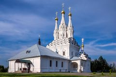 Ancient white stone orthodox church with golden domes in Vyazemsky Ioanno-Predtechensky Monastery. View of The Ancient white stone orthodox church with golden royalty free stock images