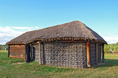 Ancient wicker barn with a straw roof. Ancient traditional ukrainian wicker rural barn Royalty Free Stock Image