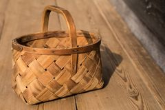 Ancient wicker basket on a wooden background. Selective focus. Free space for text. royalty free stock photo