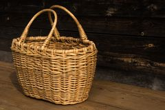 Ancient wicker basket on a wooden background. Selective focus. Free space for text. stock image