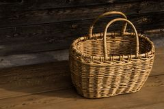 Ancient wicker basket on a wooden background. Selective focus. Free space for text. stock photos