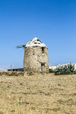 Ancient wind mill in greece, isolated on blue sky Stock Photos