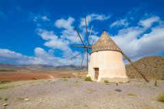 Ancient wind mill on the hill of Genoveses Beach in Gata Cape Almeria royalty free stock photography