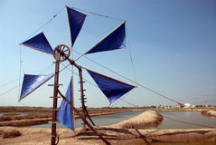 Ancient wind mill use for move the sea water into the salt field Royalty Free Stock Photography