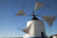 Ancient windmill in Castro Verde, Alentejo, Portugal. Ancient windmill still active in Castro Verde, Alentejo, Portugal. Inside many kilos of flower are produced Royalty Free Stock Photo