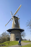 Ancient windmill the Prince of Orange and biker, Buren Stock Photos