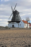 Ancient windmill, Sweden. Ancient windmill and houses, Sweden, Europe Royalty Free Stock Image