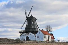Ancient windmill, Sweden. Ancient windmill and houses, Sweden, Europe Stock Photos