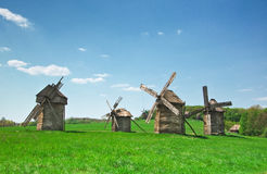 Ancient windmills in field Royalty Free Stock Photo