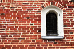 An ancient window on a red brick wall Royalty Free Stock Image