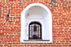 An ancient window on a red brick wall Royalty Free Stock Photography