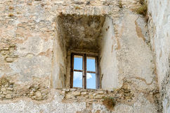 Ancient window from the ruins of an old castle Stock Photography