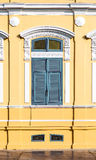 Ancient window with yellow background Stock Photo