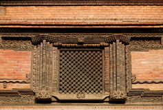 Ancient Windows with beautiful carving  in Hanuman Dhoka Durbar Stock Photo