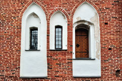 Ancient windows and door on a red brick wall Royalty Free Stock Photos