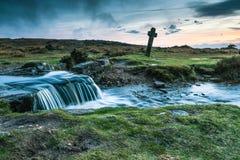 Ancient Windy Cross and wild creek in Dartmoor,UK Stock Image