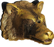 Ancient wolf head. An ancient brassy wolf head royalty free stock photography