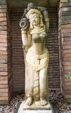 Ancient woman hold a jar sculpture Stock Photo